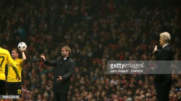 Borussia Dortmund manager Jurgen Klopp gestures from the touchline as Arsenal manager Arsene Wenger looks on