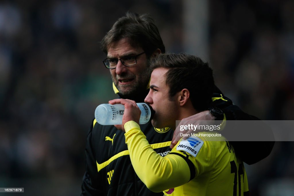 Borussia Dortmund manager Jurgen Klopp speaks to substitute Mario Gotze on the sidelines during the Bundesliga match between Borussia Dortmund and Hannover 96 at Signal Iduna Park on March 2, 2013 in Dortmund, Germany.