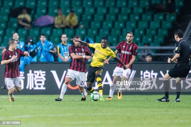 Borussia Dortmund Midfielder Ousmane Dembele fights for the ball with AC Milan Midfielder Mateo Musacchio during the International Champions Cup 2017...