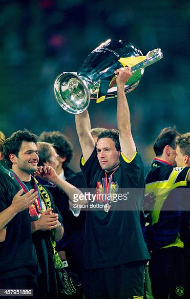 Borussia Dortmund player Paul Lambert raises the trophy after the UEFA Champions League final between Borussia Dortmund and Juventus at the Olympic...