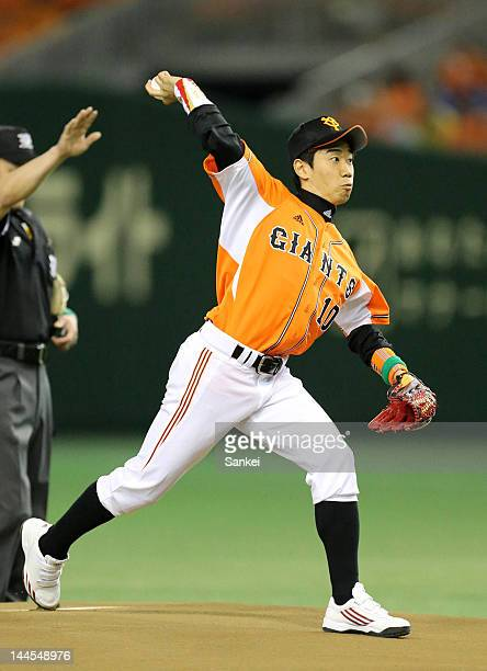 Borussia Dortmund player Shinji Kagawa throws the memorial first pitch prior to the Japanese professional baseball game at Tokyo Dome on May 16 2012...