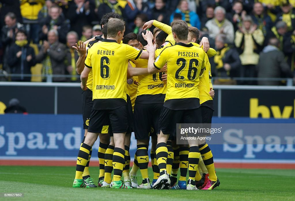 Borussia Dortmund' players celebrate after a goal during their Bundesliga soccer match between Borussia Dortmund and VfL Wolfsburg at the Signal-Iduna stadium in Dortmund, Germany on April 30, 2016.