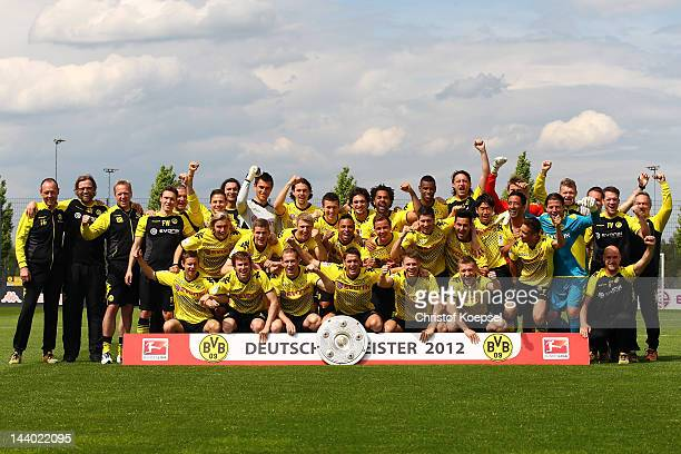 Borussia Dortmund players celebrate their Bundesliga victory with the trophy at the training ground on May 8 2012 in Dortmund Germany