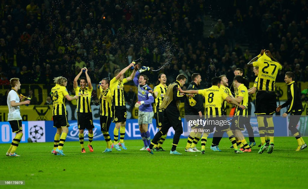 Borussia Dortmund players celebrate victory during the UEFA Champions League quarter-final second leg match between Borussia Dortmund and Malaga at Signal Iduna Park on April 9, 2013 in Dortmund, Germany.