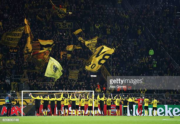 Borussia Dortmund players celebrate victory infront of their supporters during the UEFA Champions League Group F match between Borussia Dortmund and...