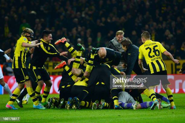 Borussia Dortmund players celebrates victory and a place in the semifinals in the UEFA Champions League quarterfinal second leg match between...