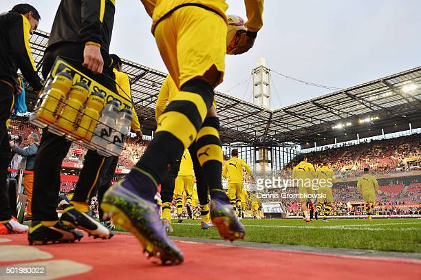Borussia Dortmund players enter the pitch to warm up prior to kickoff during the Bundesliga match between 1 FC Koeln and Borussia Dortmund at...