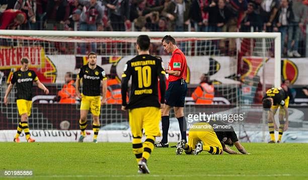 Borussia Dortmund players look dejected after conceding a goal during the Bundesliga match between 1 FC Koeln and Borussia Dortmund at...