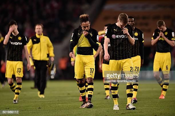 Borussia Dortmund players look dejected after the Bundesliga match between 1 FC Koeln and Borussia Dortmund at RheinEnergieStadion on December 19...