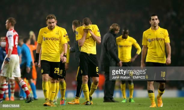 Borussia Dortmund players Marcel Schmelzer Sven Bender and Henrik Mkhitaryan dejected after the match