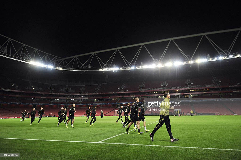 Borussia Dortmund players warm up during a training session at the Emirates Stadium, North London, on October 21, 2013, on the eve of his team's UEFA Champions League Group F football match against Arsenal.