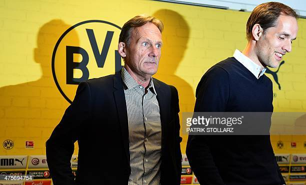 Borussia Dortmund ´s CEO HansGuenther Watzke and new coach Thomas Tuchel attend a press conference of first division Bundesliga football club...