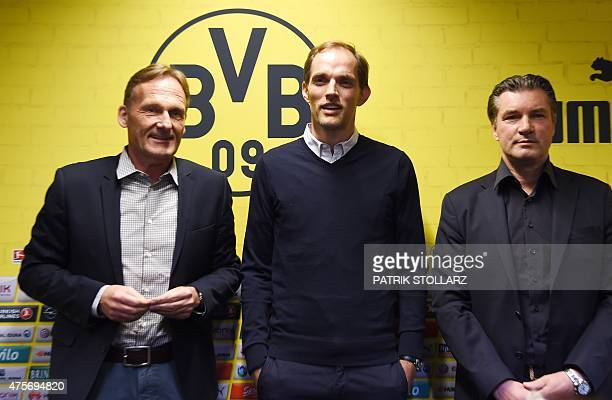 Borussia Dortmund ´s CEO HansGuenther Watzke new coach Thomas Tuchel and manager Michael Zorc attend a press conference of first division Bundesliga...