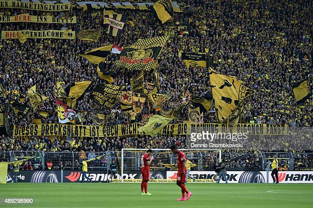Borussia Dortmund supporters present a banner during the Bundesliga match between Borussia Dortmund and Bayer Leverkusen at Signal Iduna Park on...
