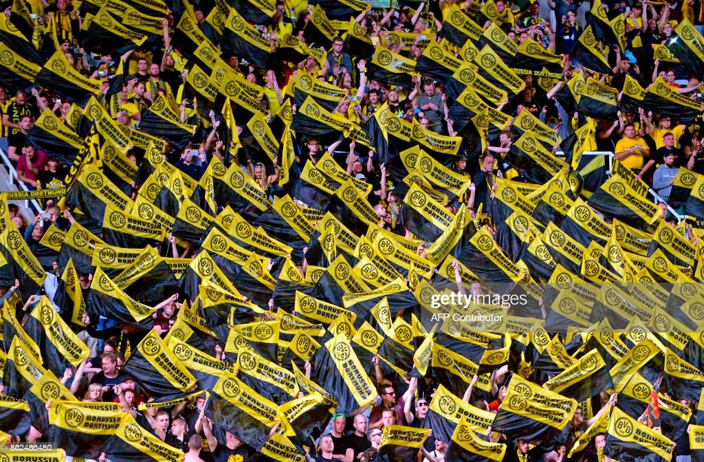 Borussia Dortmund supporters wave flags during the UEFA Champions League football match between Apoel FC and Borussia Dortmund at the GSP Stadium in the Cypriot capital, Nicosia on October 17, 2017. /