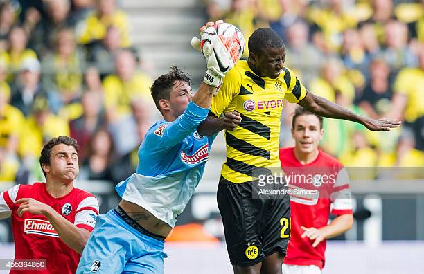 Borussia Dortmund's Adrian Ramos in action against Freiburg's goal keeper Roman Buerki during the Bundesliga match between SC Freiburg and Borussia...