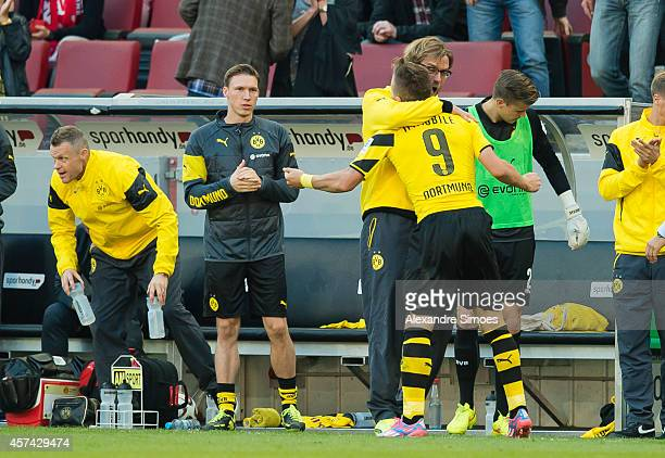 Borussia Dortmund's Ciro Immobile celebrates with his head coach Juergen Klopp after scoring their first goal during the Bundesliga match between 1...