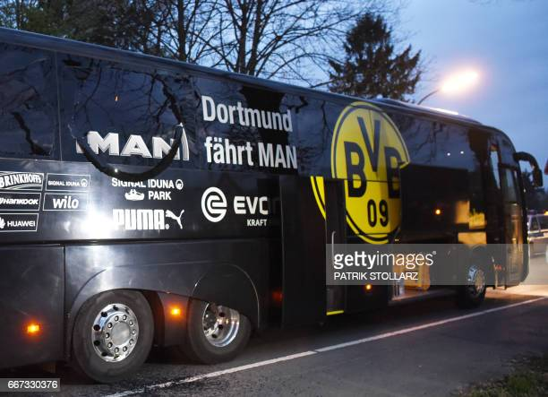 TOPSHOT Borussia Dortmund's damaged bus is pictured after an explosion some 10km away from the stadium prior to the UEFA Champions League 1st leg...