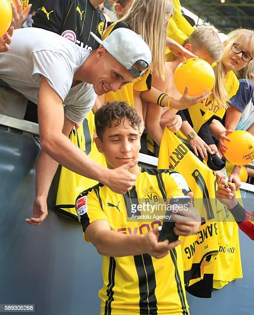 Borussia Dortmund's Emre Mor takes a selfie with a fan of Borussia Dortmund as he attends the season opening and public training session in the...