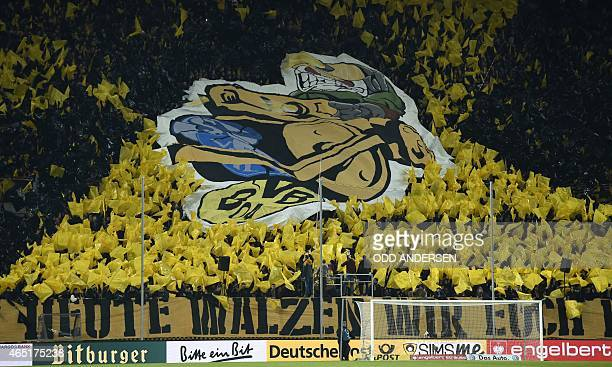 Borussia Dortmund's fans wave during the German football Cup DFB Pokal round of 16 game between German third division Dynamo Dresden and first...