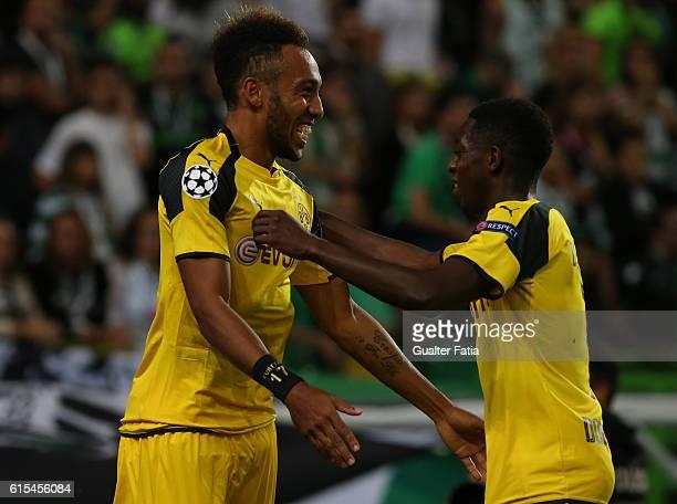 Borussia DortmundÕs forward PierreEmerick Aubameyang celebrates with teammate Borussia DortmundÕs forward Ousmane Dembele after scoring a goal during...