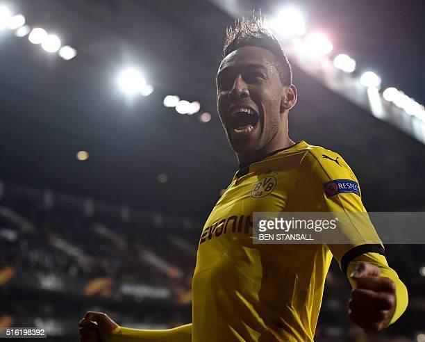 Borussia Dortmund's Gabonese striker PierreEmerick Aubameyang celebrates after scoring their second goal during the UEFA Europa League round of 16...