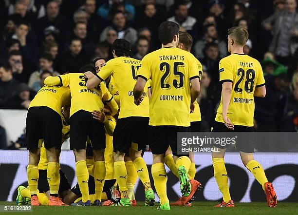Borussia Dortmund's Gabonese striker PierreEmerick Aubameyang celebrates with teammates after scoring the opening goal of the UEFA Europa League...