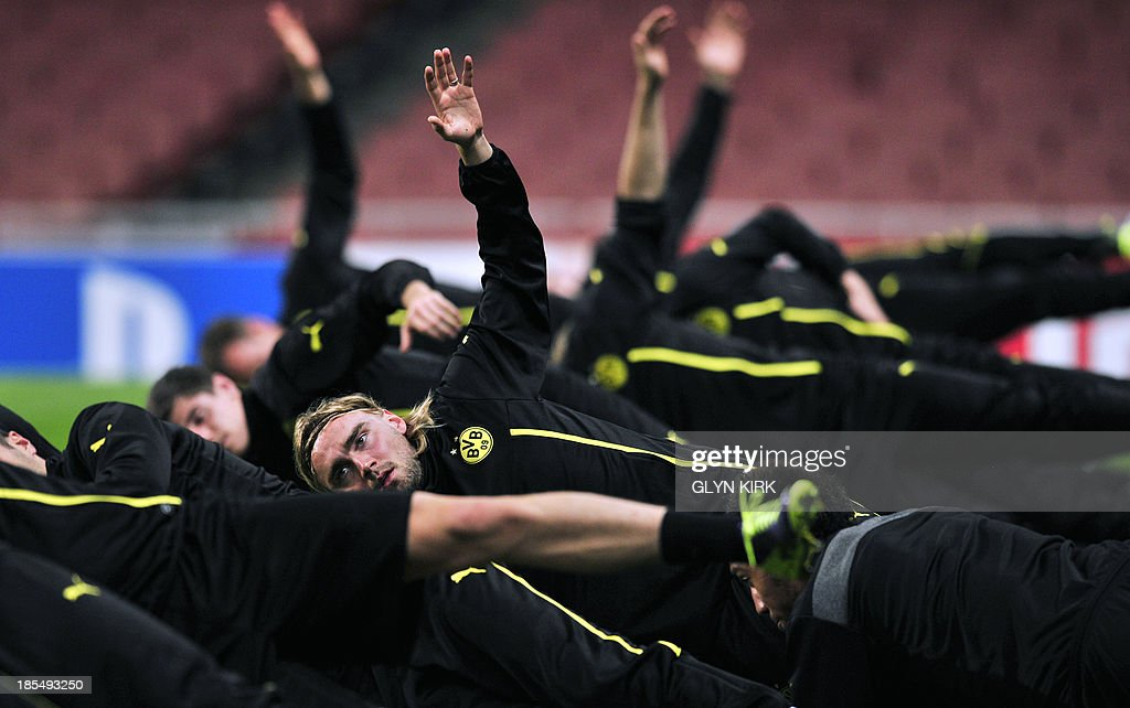 Borussia Dortmund's German defender Marcel Schmelzer (C) attends a training session at the Emirates Stadium, North London, on October 21, 2013, on the eve of his team's UEFA Champions League Group F football match against Arsenal.