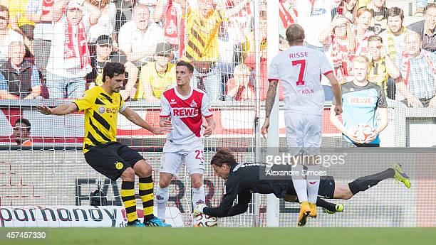 Borussia Dortmund's goal keeper Roman Weidenfeller and Mats Julian Hummels in action during the Bundesliga match between 1 FC Koeln and Borussia...