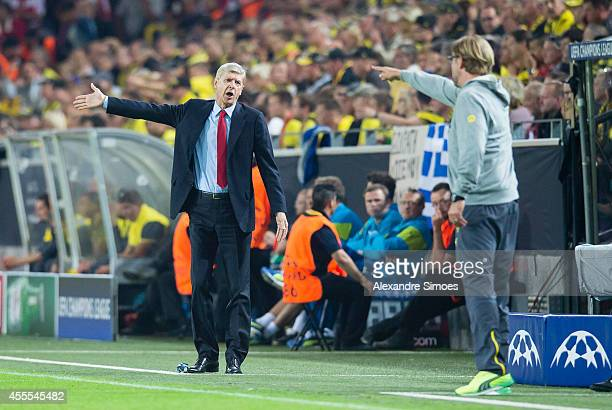 Borussia Dortmund's head coach Juergen Klopp and Arsenal's head coach Arsene Wenger in conversation during the UEFA Champions League first round...