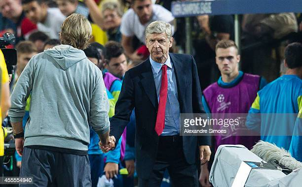 Borussia Dortmund's head coach Juergen Klopp and Arsenal's head coach Arsene Wenger shake hands after the UEFA Champions League first round between...