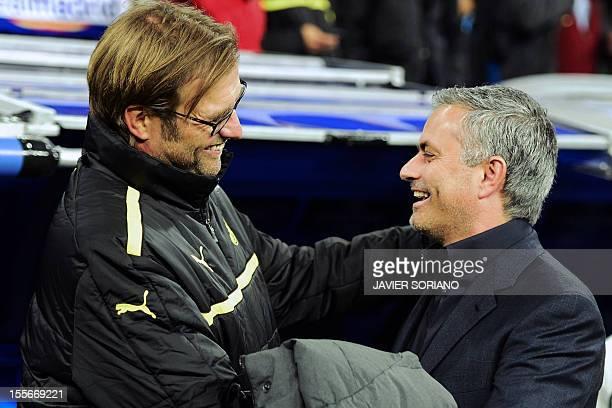Borussia Dortmund's head coach Juergen Klopp greets Real Madrid's Portuguese coach Jose Mourinho before the UEFA Champions League football match Real...