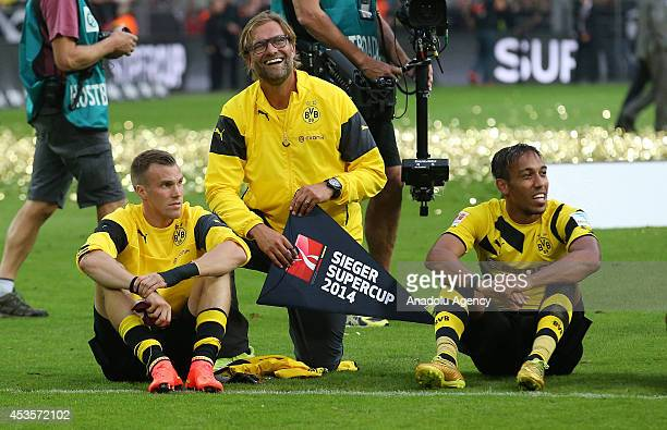 Borussia Dortmund's head coach Juergen Klopp Kevin Grosskreuz and Aubameyang of Borussia Dortmund celebrate after the DFL Supercup 2014 match between...