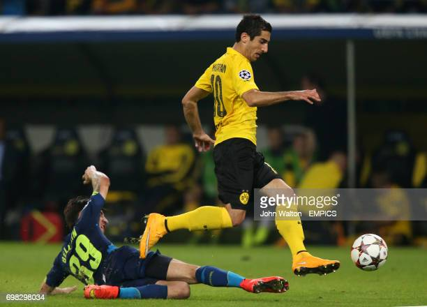 Borussia Dortmund's Henrikh Mkhitaryan right is tackled by Arsenal's Arsenal's Hector Bellerin left