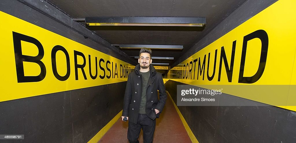 Borussia Dortmund's injured midfielder Ilkay Guendogan is seen before the Bundesliga match between Borussia Dortmund and 1. FSV Mainz 05 at Signal Iduna Park on April 19, 2014 in Dortmund, Germany.
