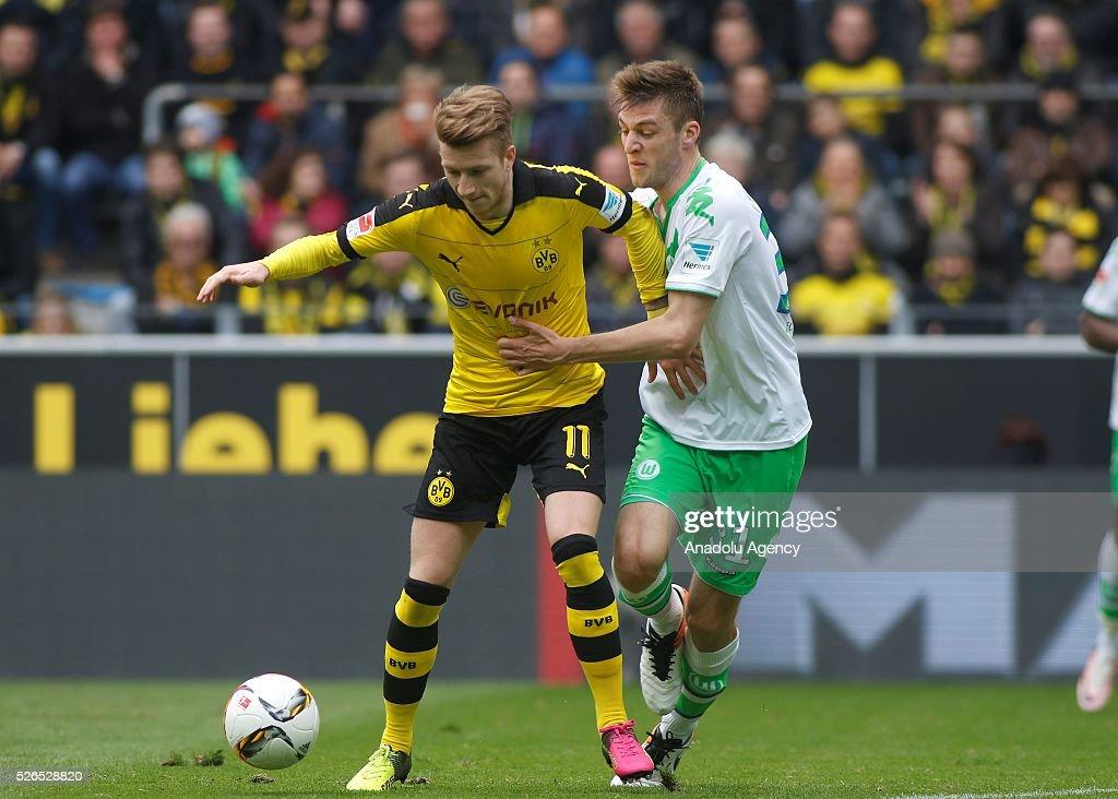 Borussia Dortmund's Marco Reus (L) and VfL Wolfsburg's Robin Knoche during their Bundesliga soccer match between Borussia Dortmund and VfL Wolfsburg at the Signal-Iduna stadium in Dortmund, Germany on April 30, 2016.