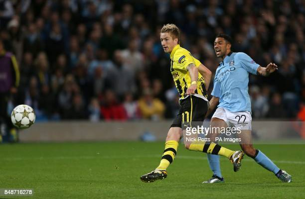 Borussia Dortmund's Marco Reus scores their first goal of the game