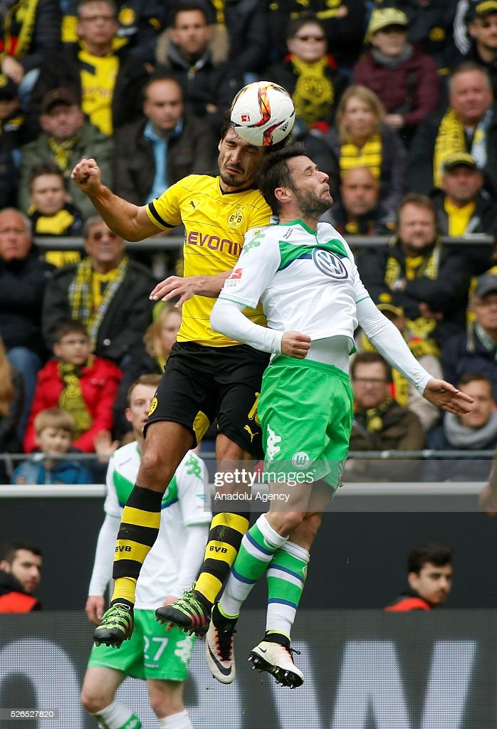 Borussia Dortmund's Mats Hummels (L) and VfL Wolfsburg's Christian Traesch in action during their Bundesliga soccer match between Borussia Dortmund and VfL Wolfsburg at the Signal-Iduna stadium in Dortmund, Germany on April 30, 2016.