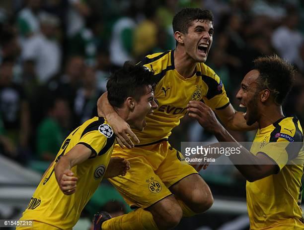 Borussia DortmundÕs midfielder Julian Weigl celebrates with teammates Borussia DortmundÕs midfielder Christian Pulisic and Borussia DortmundÕs...