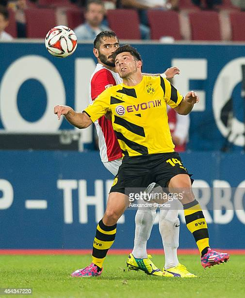 Borussia Dortmund's Milos Jojic in action against Augsburg's Halil Altintop during the Bundesliga match between FC Augsburg and Borussia Dortmund at...