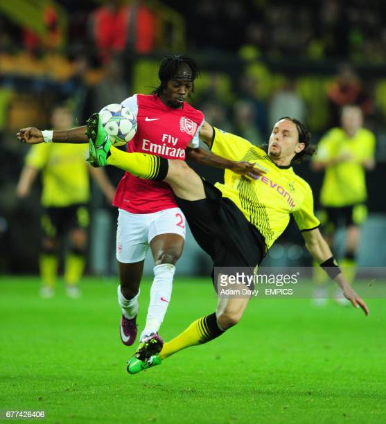 Borussia Dortmund's Neven Subotic and Arsenal's Gervinho battle for the ball
