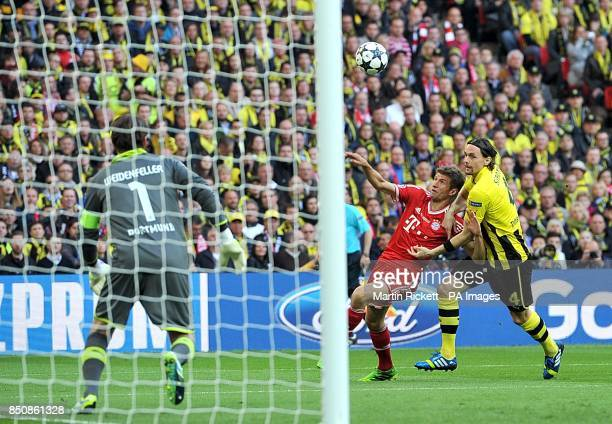 Borussia Dortmund's Neven Subotic and Bayern Munich's Thomas Muller battle for the ball