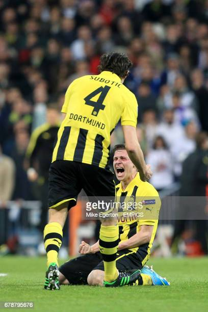 Borussia Dortmund's Neven Subotic and Lukasz Piszczek celebrate their aggregate victory after the final whistle