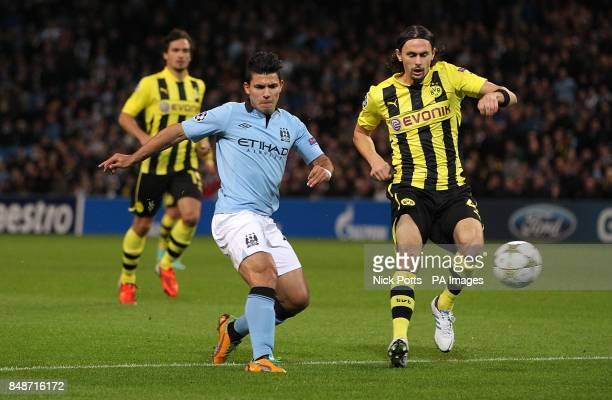 Borussia Dortmund's Neven Subotic and Manchester City's Sergio Aguero in action