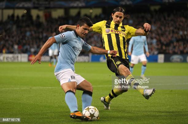 Borussia Dortmund's Neven Subotic and Manchester City's Sergio Aguero battle for the ball