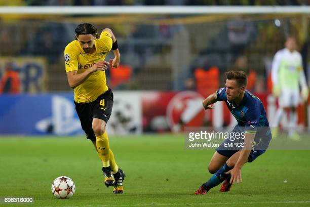 Borussia Dortmund's Neven Subotic skips away from Arsenal's Aaron Ramsey
