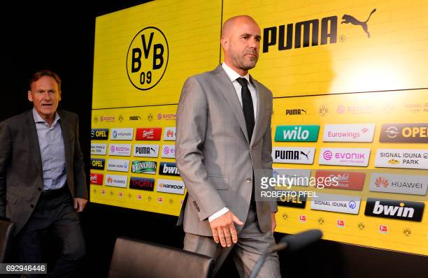 Borussia Dortmund's new headcoach Peter Bosz from the Netherlands and Dortmund's CEO HansJoachim Watzke arrive for a press conference on June 6 in...