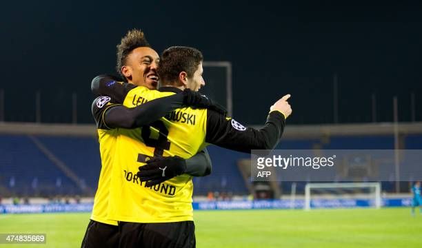 Borussia Dortmund's PierreEmerick Aubameyang and Robert Lewandowski celebrate after scoring a goal against Zenit Saint Petersburg during their UEFA...
