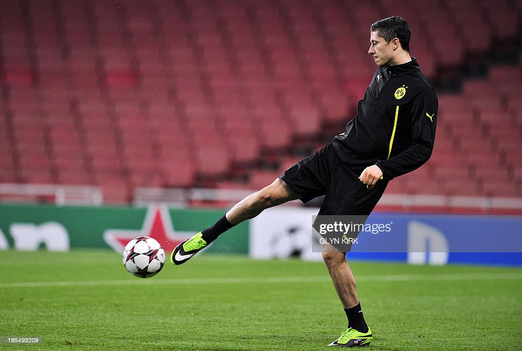 Borussia Dortmund's Polish striker Robert Lewandowski attends a training session at the Emirates Stadium, North London, on October 21, 2013, on the eve of his team's UEFA Champions League Group F football match against Arsenal.