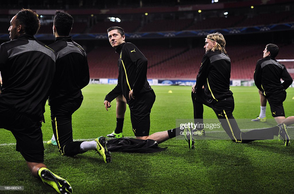Borussia Dortmund's Polish striker Robert Lewandowski attends a training session at the Emirates Stadium, North London, on October 21, 2013, on the eve of his team's UEFA Champions League Group F football match against Arsenal.